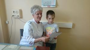 Раиса Филиппова с юным пациентом